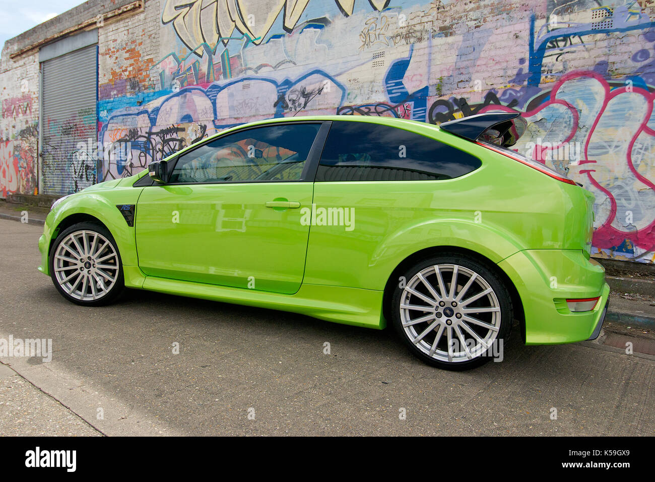 Lime Green Ford Focus Rs Against A Graffiti Covered Wall Stock Photo