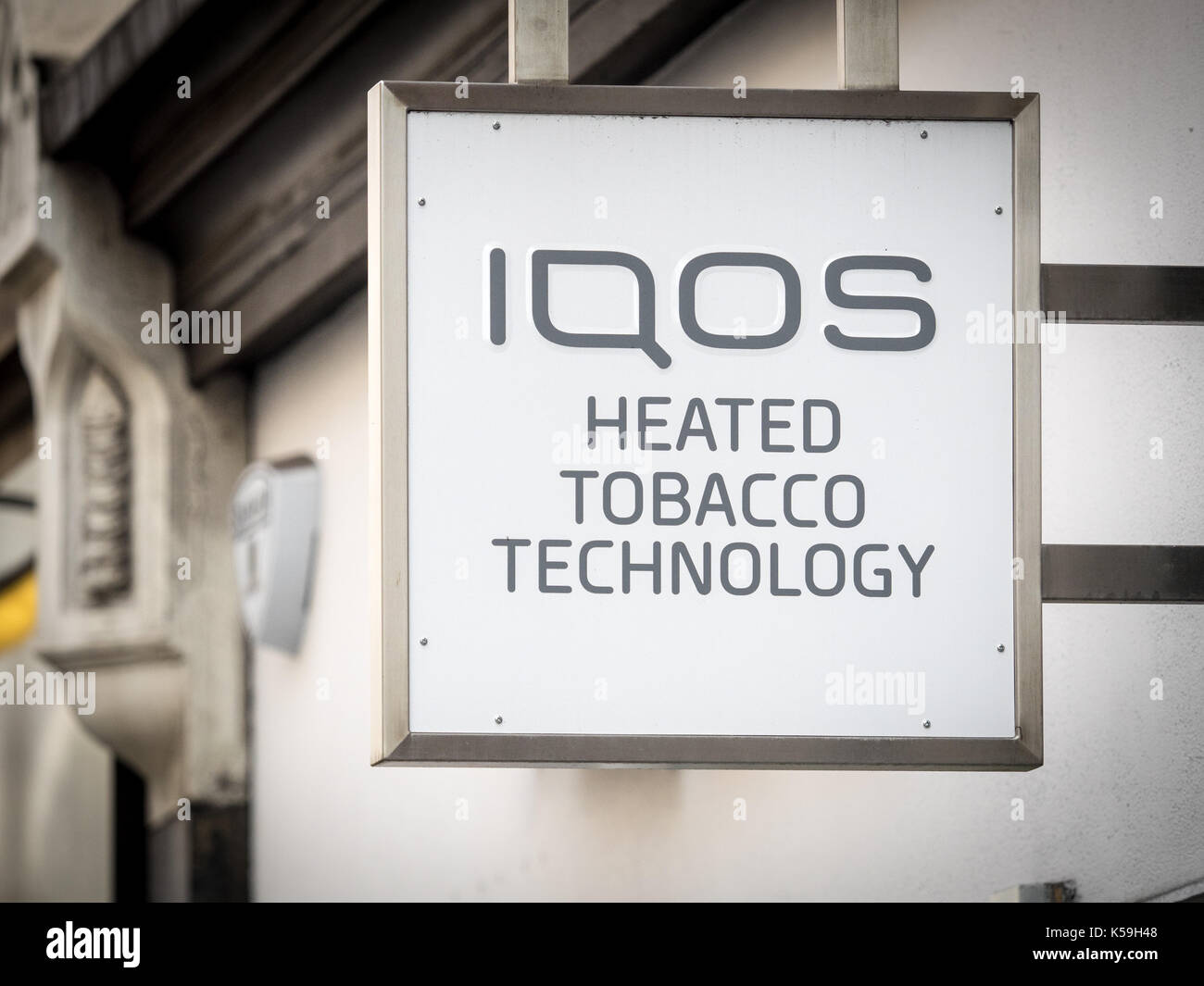 IQOS Technology sign outside a shop in Soho London - IQOS is marketed by Philip Morris International and is a heat-not-burn product - Stock Image