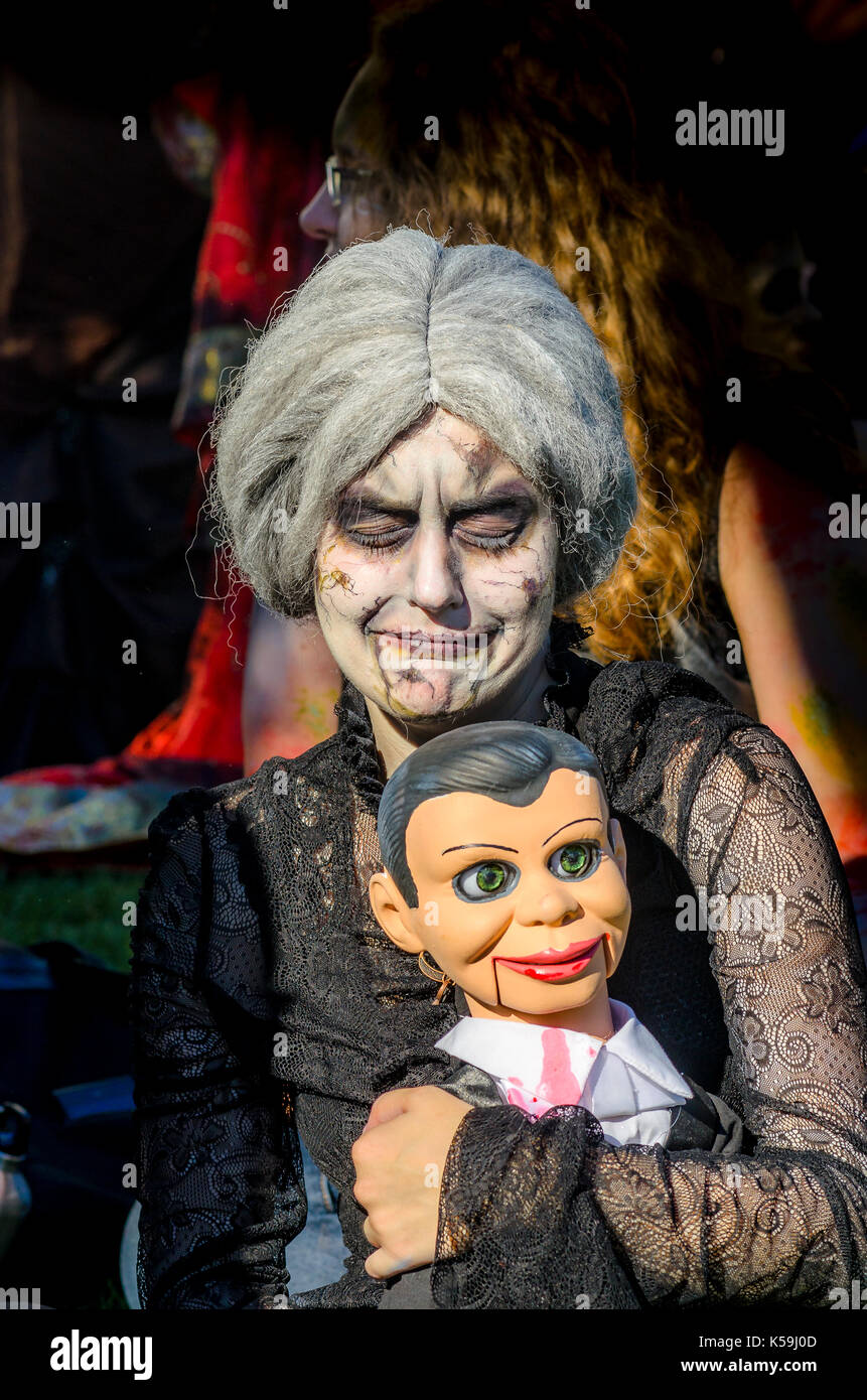 Zombie ventriloquist and dummy, The Vancouver Zombiewalk, Morton Park, West End, Vancouver, British Columbia, Canada. - Stock Image