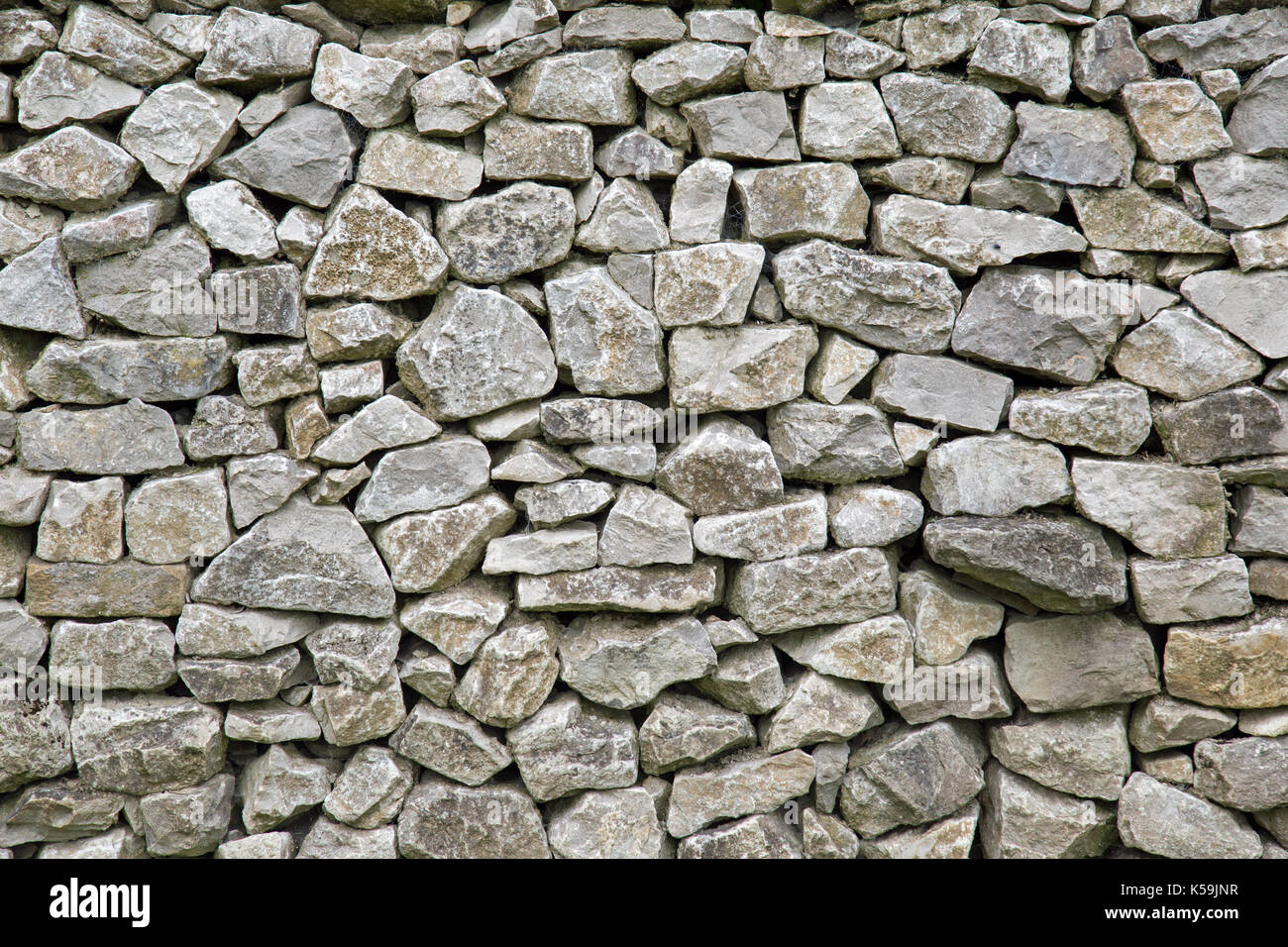 Dry stone wall texture background - Stock Image