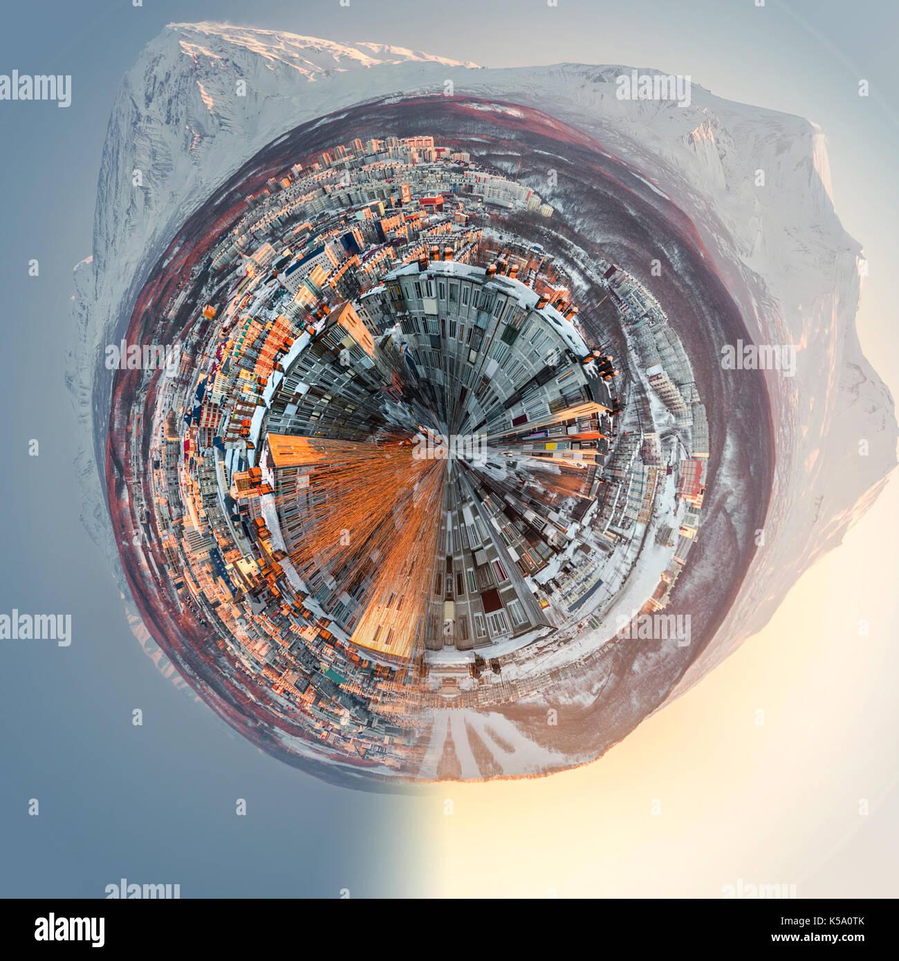 Little planet 360 degree sphere. Petropavlovsk-Kamchatsky cityscape. Sunrise over Koryaksky and Avachinsky volcanoes. Far East, Russia - Stock Image