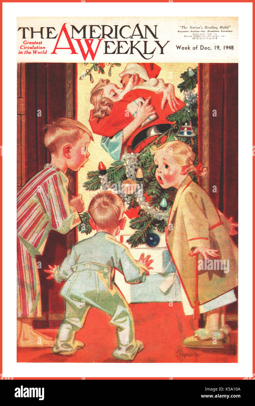 VINTAGE RETRO CHRISTMAS FRONT COVER SCENE 1940's Post War American Weekly showing halcyon happy surprised family of two young boys and a girl watching Father dressed as Father Christmas kissing Mother by the Christmas tree, under the mistletoe. The American Weekly was a Sunday newspaper supplement published by the Hearst Corporation from November 1, 1896, until 1966. - Stock Image