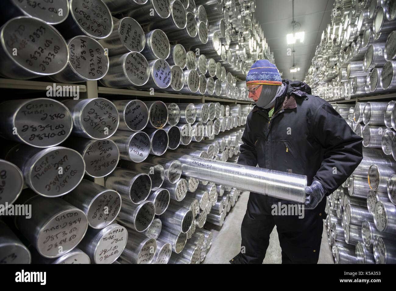 Denver, Colorado - Geoff Hargreaves, curator at the National Ice Core Laboratory, holds a one-meter section of an ice core stored at -36 degrees C (-3 - Stock Image
