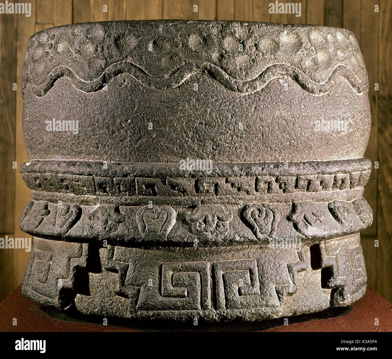Precolumbian Period. Aztec. Huehuetl. Representacion made in stone of an Aztec drum. From Mexico DF. Anthropology Museum of Mexico. - Stock Image