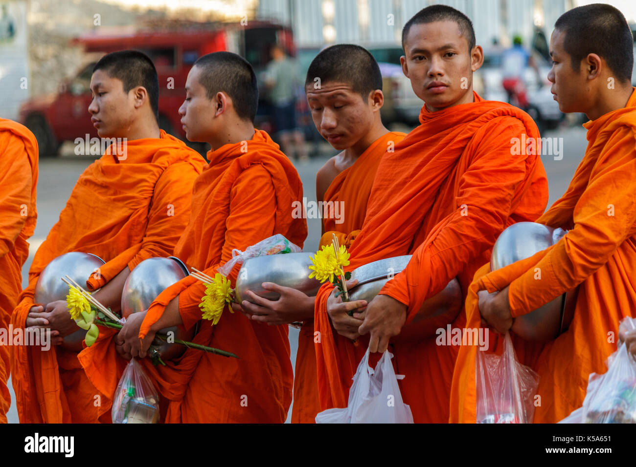CHIANG MAI, THAILAND - 1/8/2016: Young monks collect donations in Chiang Mai, Thailand. - Stock Image