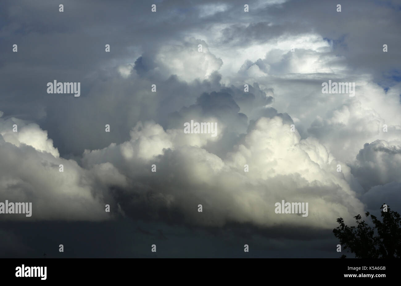 Cumulonimbus strorm clouds building on a warm summer's afternoon. - Stock Image