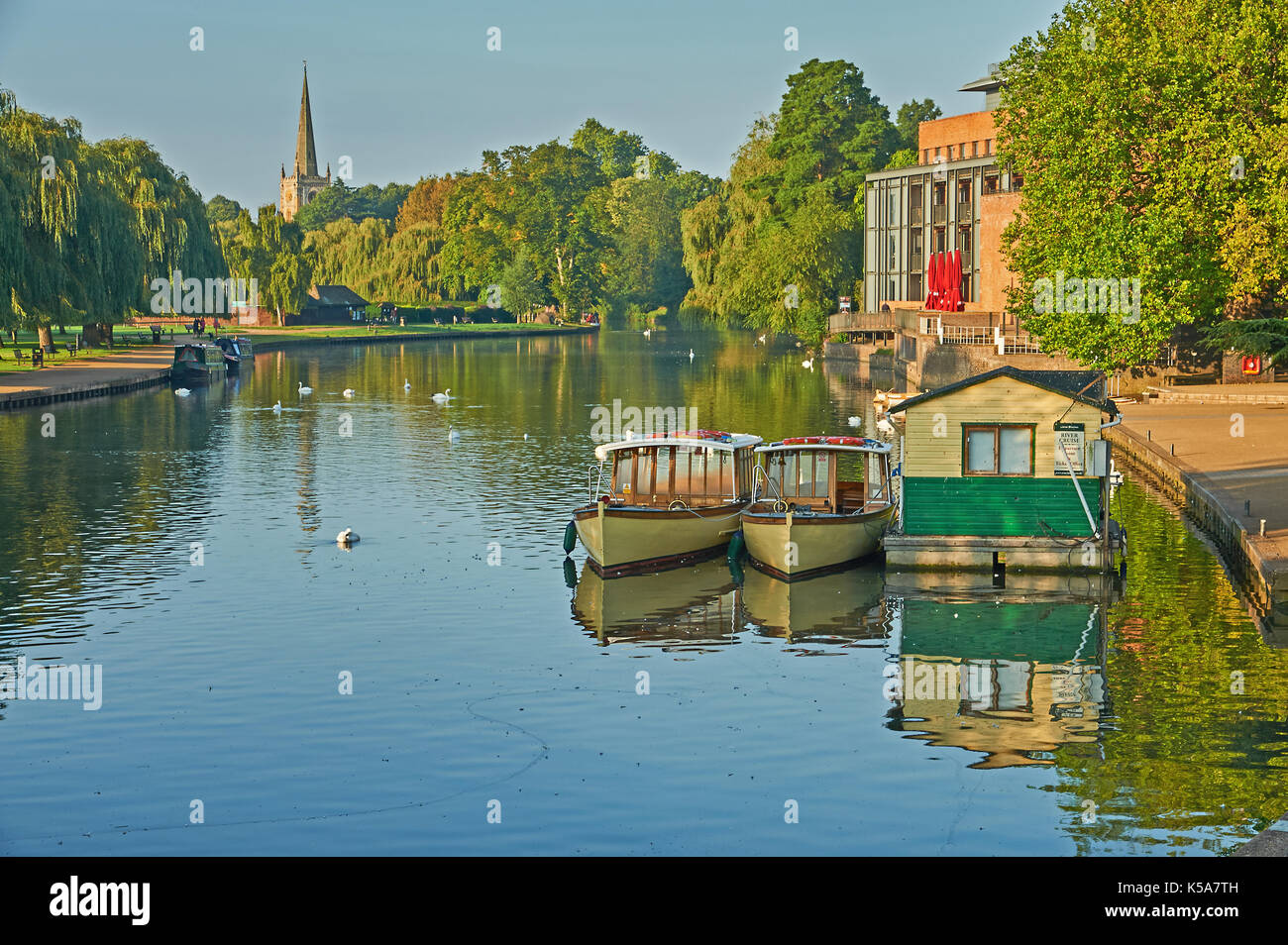 Stratford upon Avon and early morning autumn reflections on the River Avon with the view towards Holy Trinity church - Stock Image