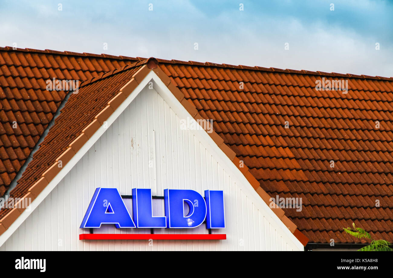 TEMPLIN, GERMANY - AUG 31, 2017: Detail on the façade at ALDI discount supermarket in Templin, Uckermark district of Brandenburg, Germany.  ALDI is a  - Stock Image