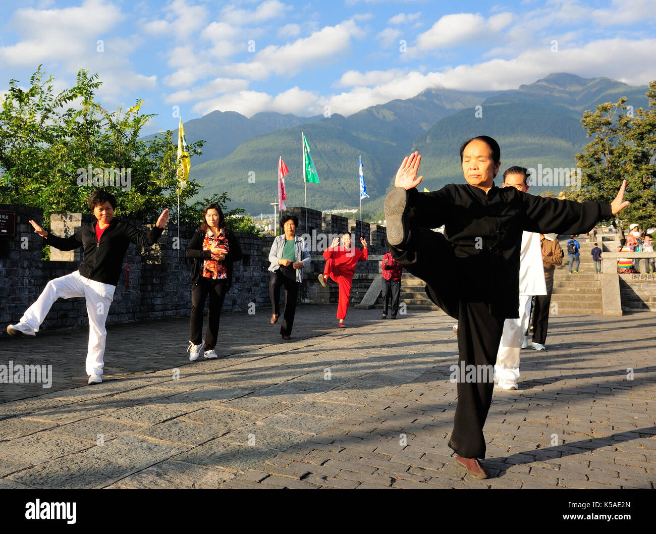 Dali,China - Oct 6,2014:People practice tai chi at Dali ancient town in Yunnan province of China. - Stock Image