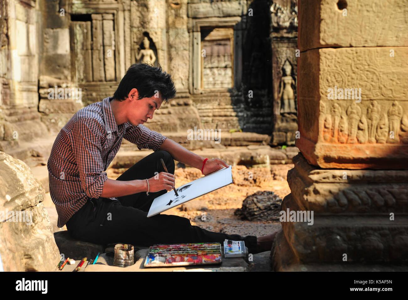 Siem Reap,Cambodia - Feb 10,2013:Artist painting in ruins of Angkor Wat,Siem Reap,Cambodia. - Stock Image