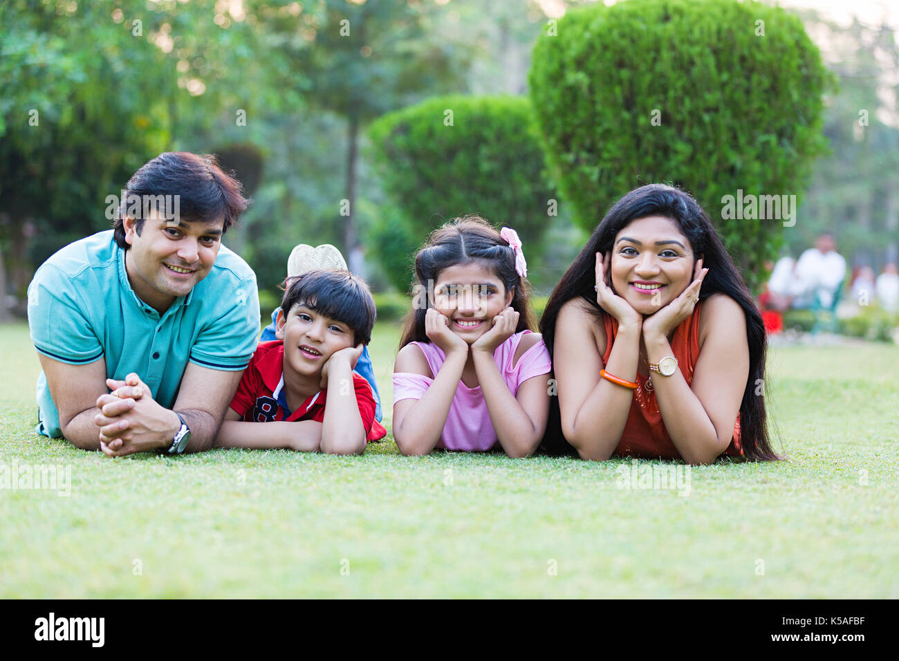 Happy Indian Family Lying Grass Relaxing Enjoying Weekend Holiday