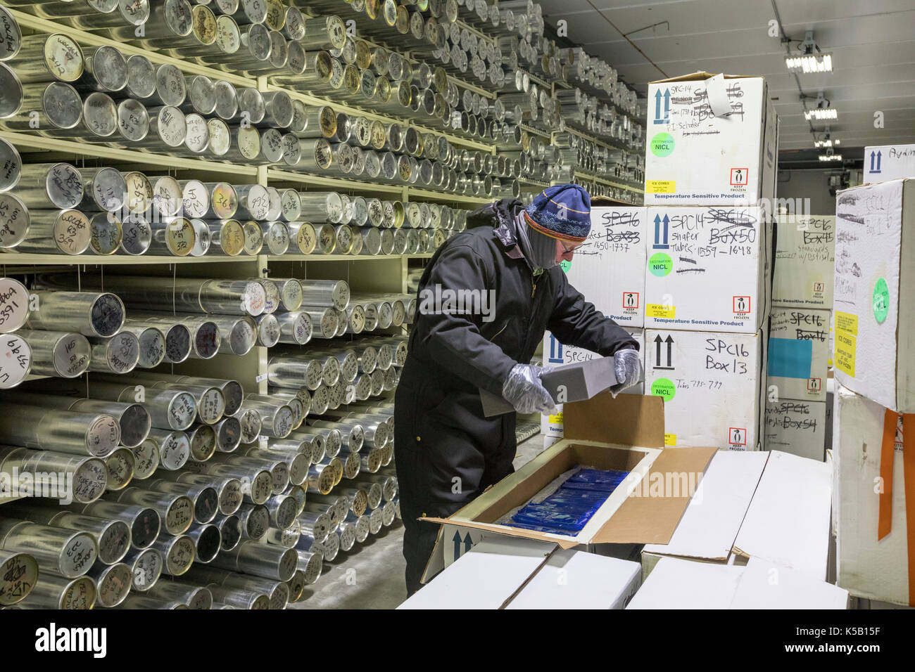 Denver, Colorado - Geoff Hargreaves, curator at the National Ice Core Laboratory, places insulation in a box of ice cores being shipped to a scientist - Stock Image