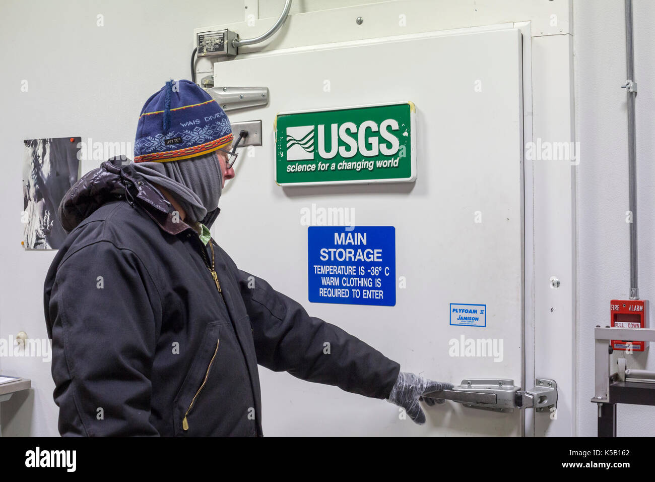 Denver, Colorado - Geoff Hargreaves, curator at the National Ice Core Laboratory, enters the storage room where ice cores are held at -36 degrees C (- - Stock Image