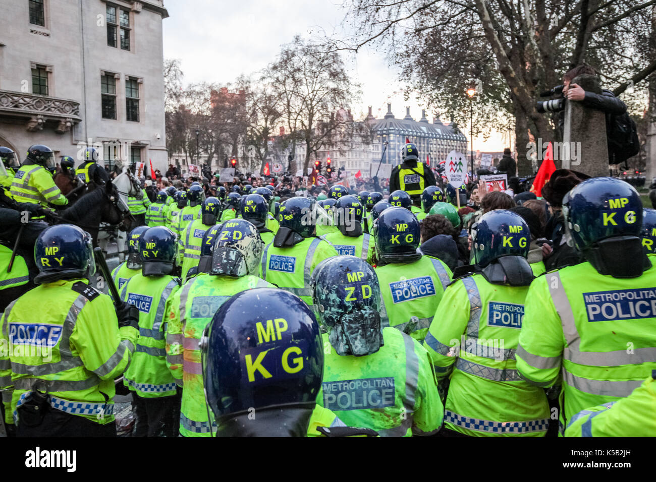 Mass student protests and civil unrest in London against increases in university tuition fees. - Stock Image