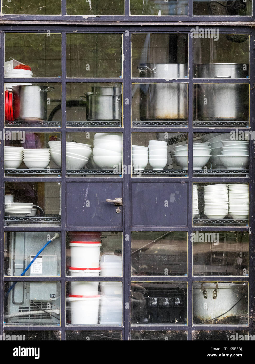 Crockery and storage jars in the window of a London restaurant near Regents Canal - Stock Image