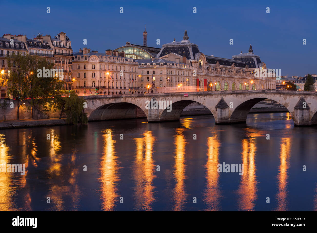 Seine River banks, Pont Royal bridge and Orsay Museum at daybreak. Paris, 7th Arrondissement, France - Stock Image