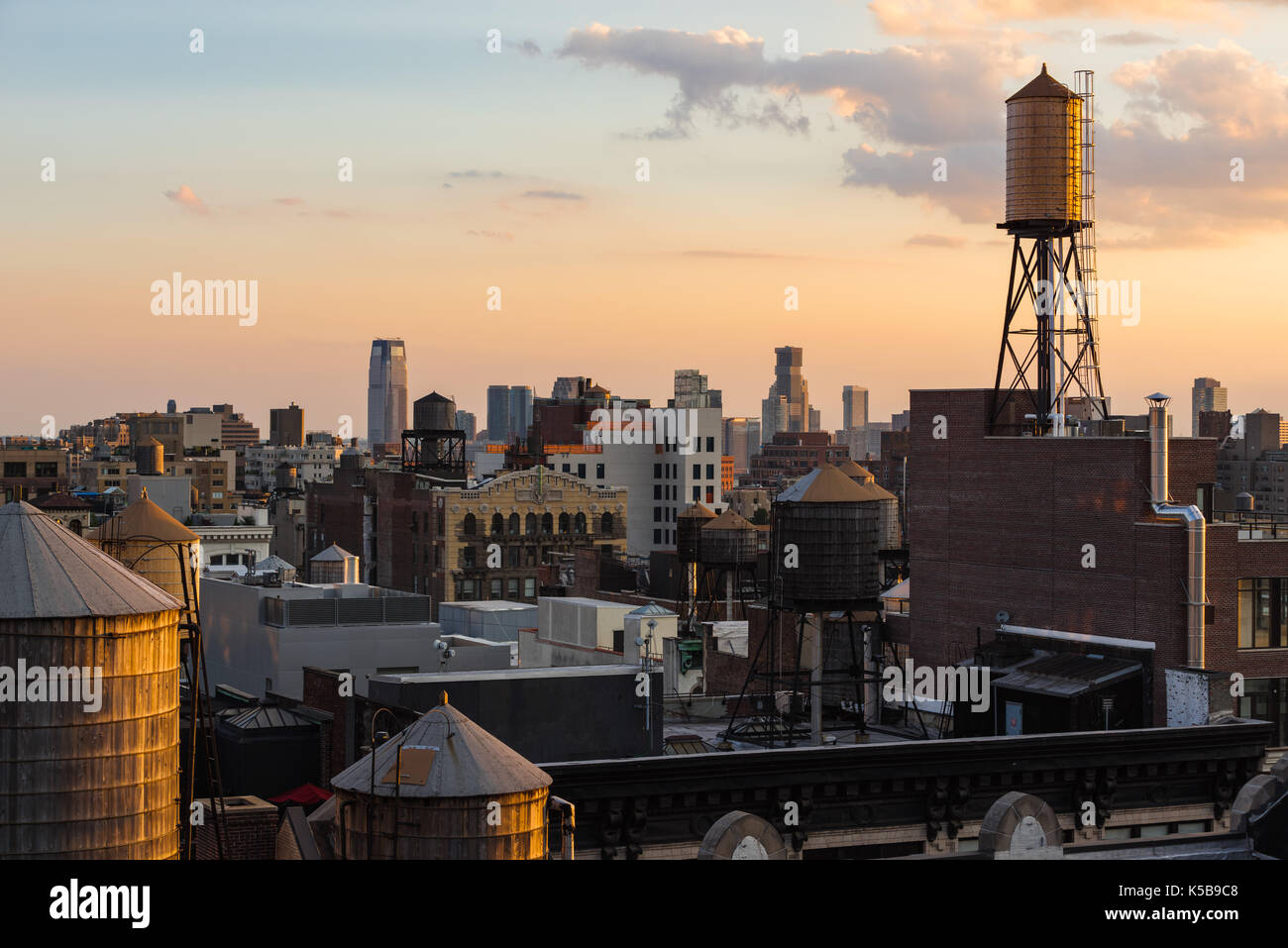 Summer sunset with Chelsea rooftops, and water towers. Manhattan, New York City - Stock Image