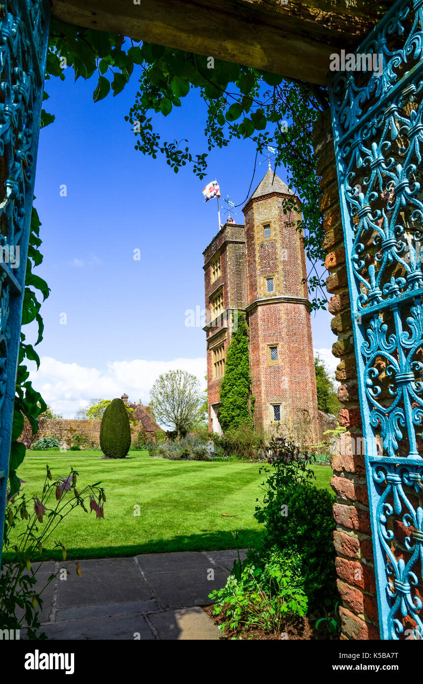 A view through the Elizabethan towers at Sissinghurst Castle Gardens in Kent, England - Stock Image