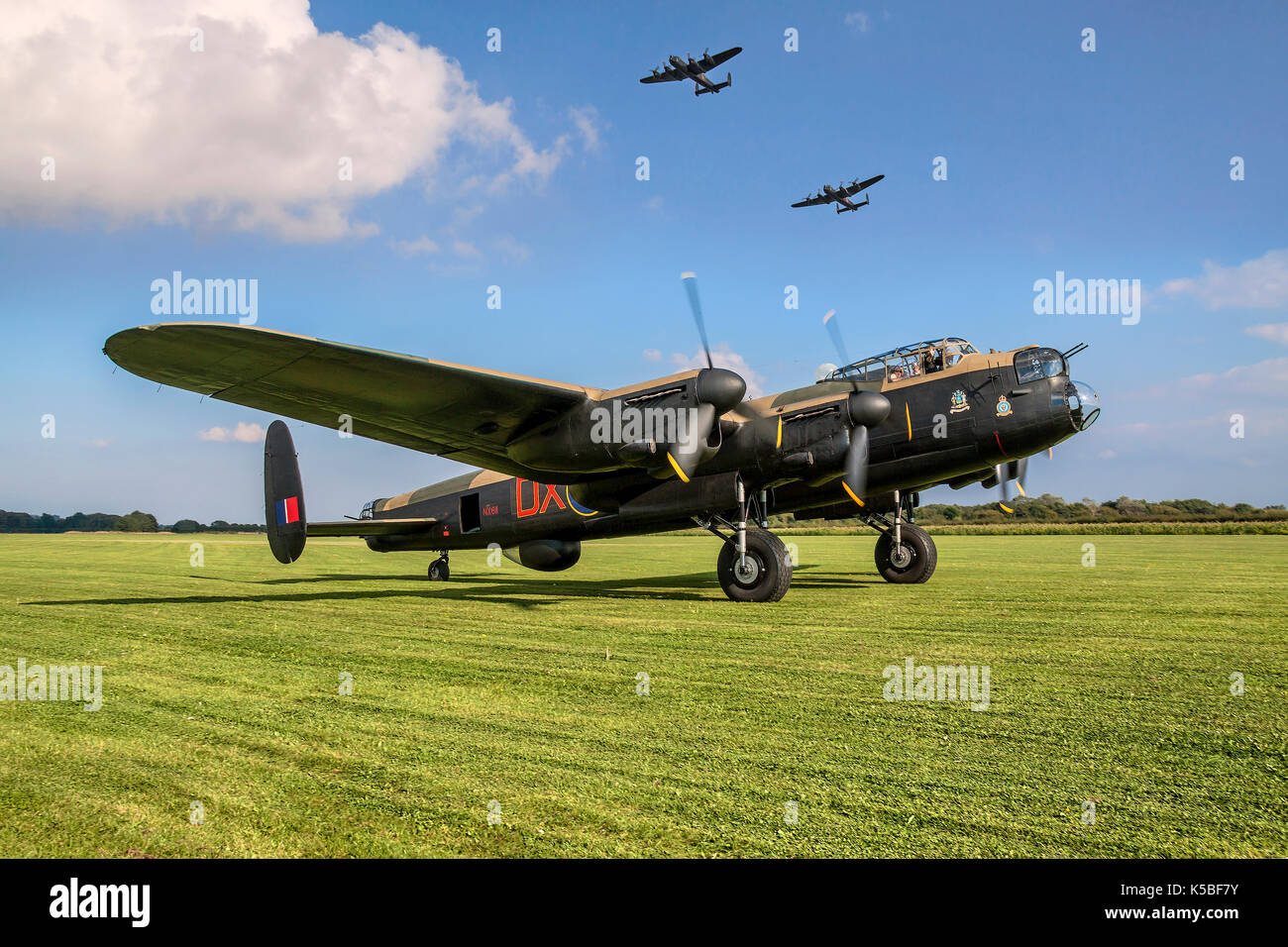 Lancasters 'City of Lincoln' and 'Vera' fly over 'Just Jane' at East Kirkby. - Stock Image