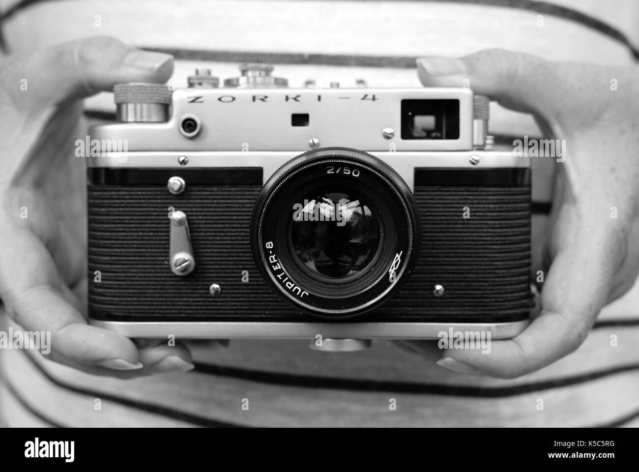 Woman holding vintage Zorki Russian rangefinder camera - Stock Image