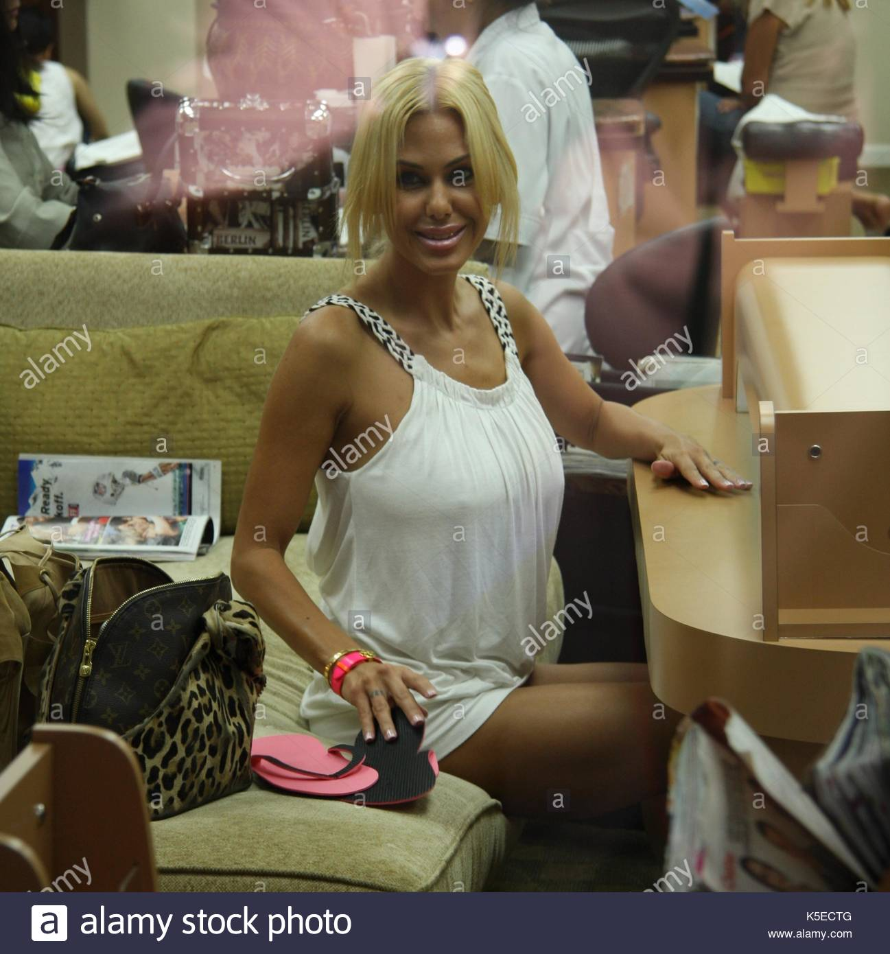 Shauna Sand. Shauna Sand giving a homeless man in a wheelchair money ...