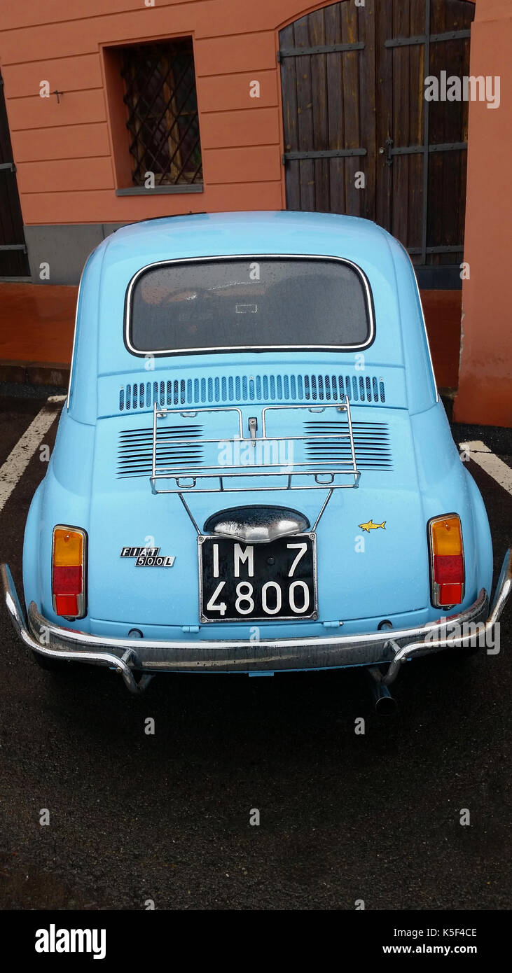 Ventimiglia, Italy - October 23, 2016: Small Italian Car Fiat 500 Parked on the Street of Ventimiglia. Blue Fiat 500 L - Stock Image