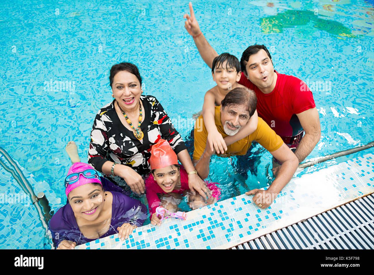 Indian Big Family Bathing swimming pool Hotel having fun - Stock Image