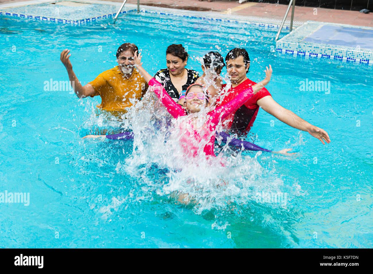 Happy Big Family Bathing Swimming pool Hotel Having fun - Stock Image