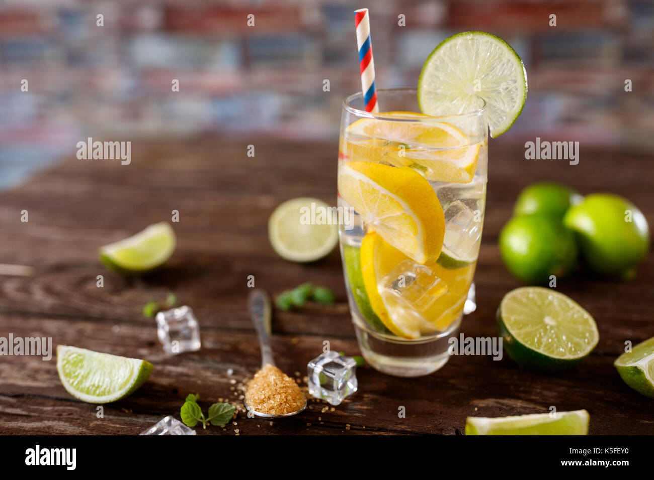 fresh cocktail citrus fruit with water dieting in glass- healthy lifestyle concept - Stock Image