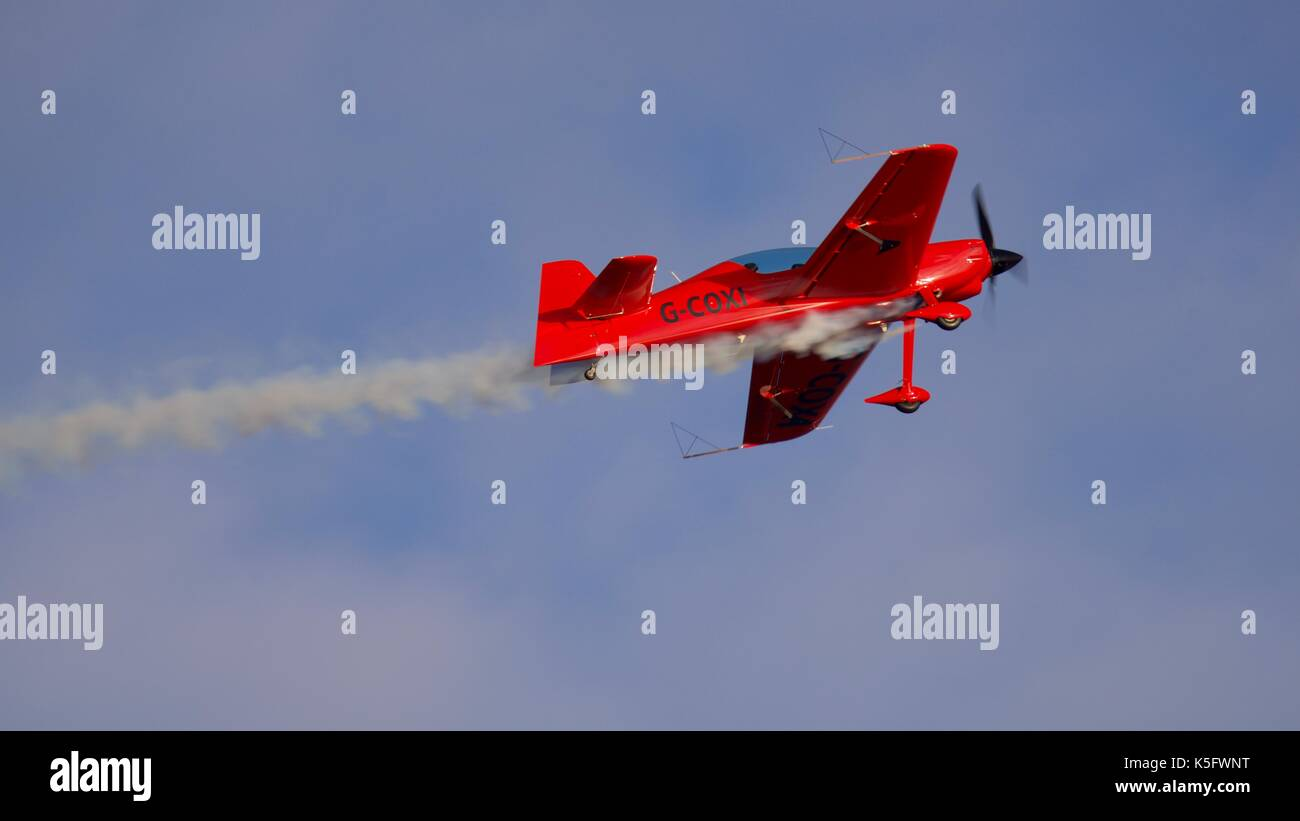 Gerald Cooper flying an XtremeAir XA42 at Bournemouth Air Festival - Stock Image