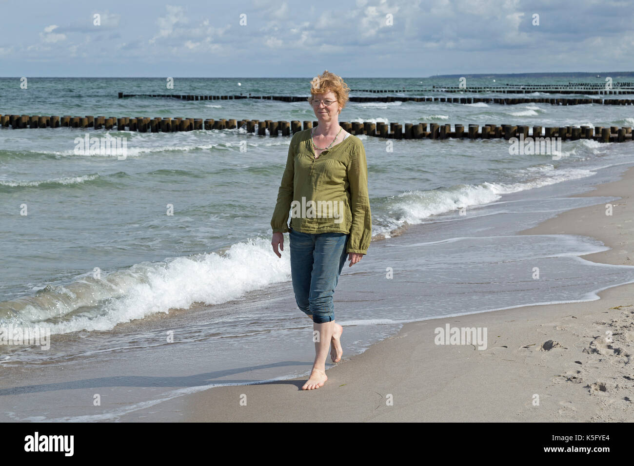 woman at the beach, Ahrenshoop, Fischland, Mecklenburg-West Pomerania, Germany - Stock Image
