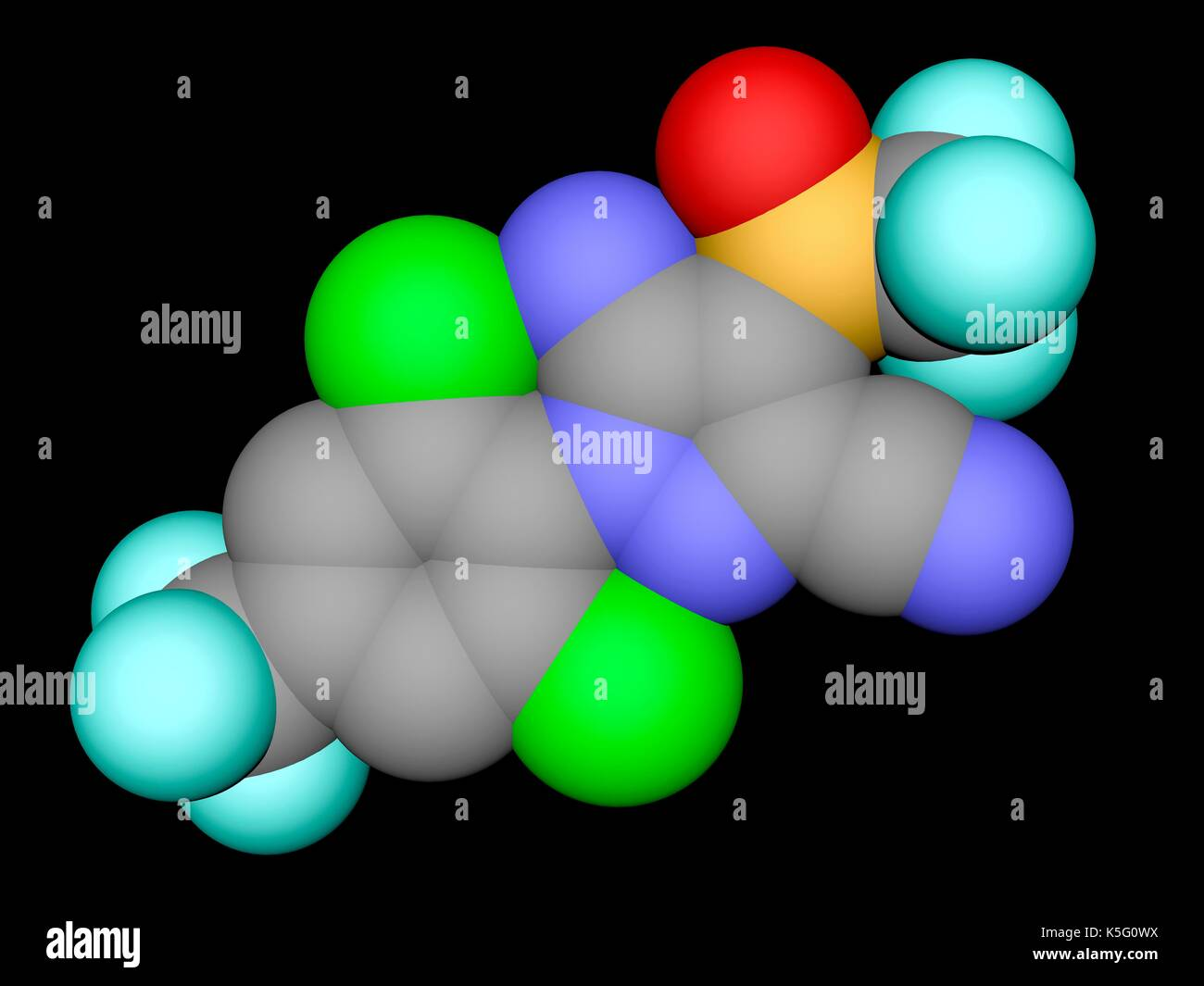 Fipronil insecticide, space filling molecular model. Atoms are represented as spheres with colour coding: carbon (grey), oxygen (red), nitrogen (blue), chlorine (green), fluorine (cyan), sulphur (yellow). Hydrogens are hidden. - Stock Image