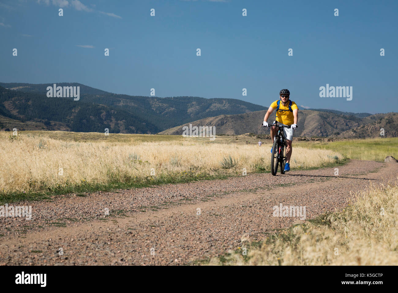 Golden Colorado A Mountain Biker On A Trail In North