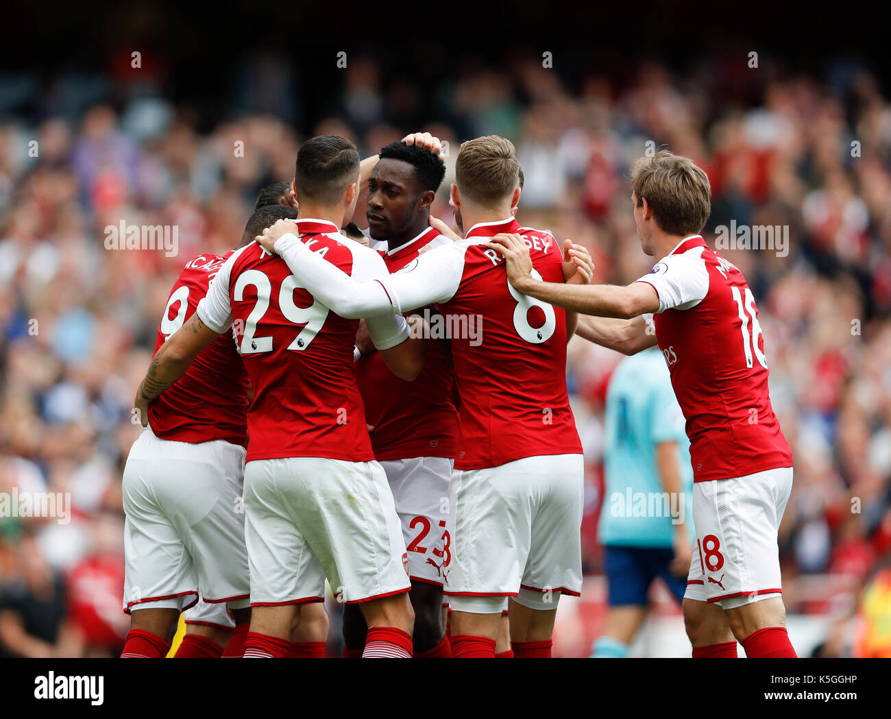 London, UK. 9th Sep, 2017. Players of Arsenal celebrate their first goal during the English Premier League match between Arsenal and Bournemouth at the Emirates Stadium in London, Britain on Sept. 9, 2017. Credit: Han Yan/Xinhua/Alamy Live News - Stock Image