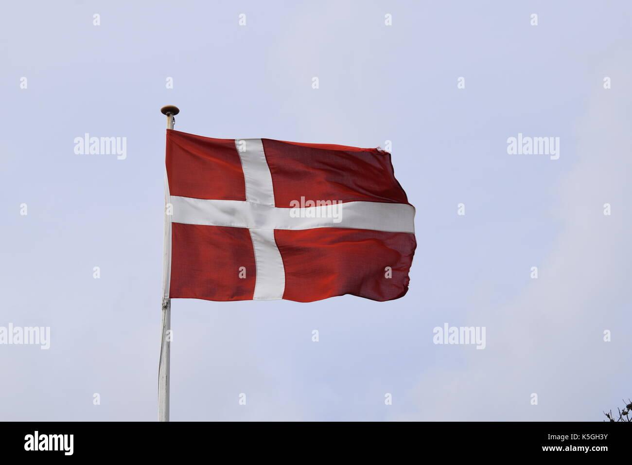 Henne Strand, Denmark. 16th Aug, 2017. The Danish flag (Danish: Dannebrog) flies in Henne Strand, Denmark, 16 August 2017. NO WIRE SERVICE. Photo: Tim Brakemeier/dpa-Zentralbild/ZB/dpa/Alamy Live News - Stock Image