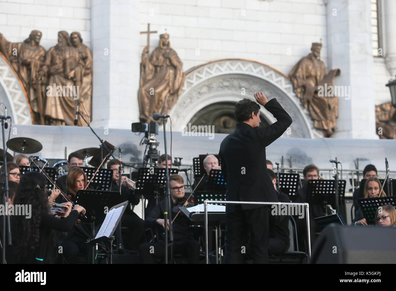 Moscow, Russia. 9th Sep, 2017. A symphony orchestra performs by the Christ the Saviour Cathedral during celebrations marking the 870th birthday of Moscow. Credit: Andrei Makhonin/TASS/Alamy Live News - Stock Image