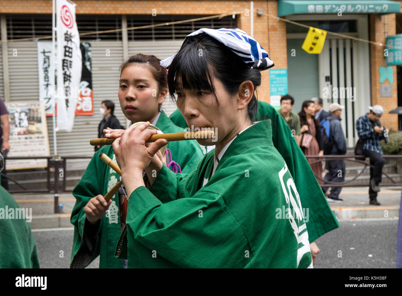 Tokyo, Japan - May 14, 2017: Woman in traditional kimono playing the flute in the festival parade at the Kanda Matsuri Festival - Stock Image