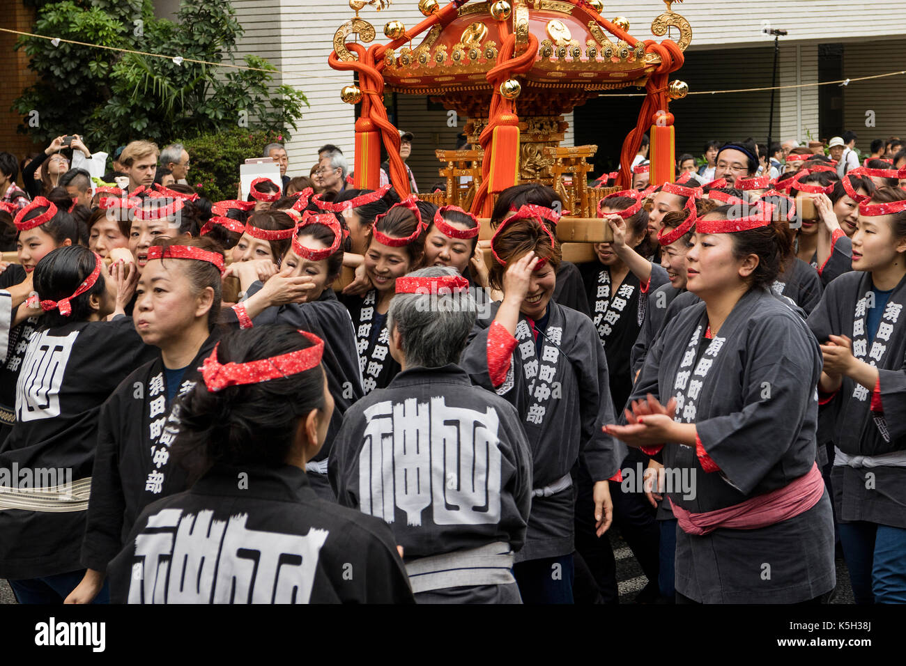 Tokyo, Japan - May 14, 2017: Kanda Matsuri Festival, a parade of portable shrines named mikoshi carried by women - Stock Image