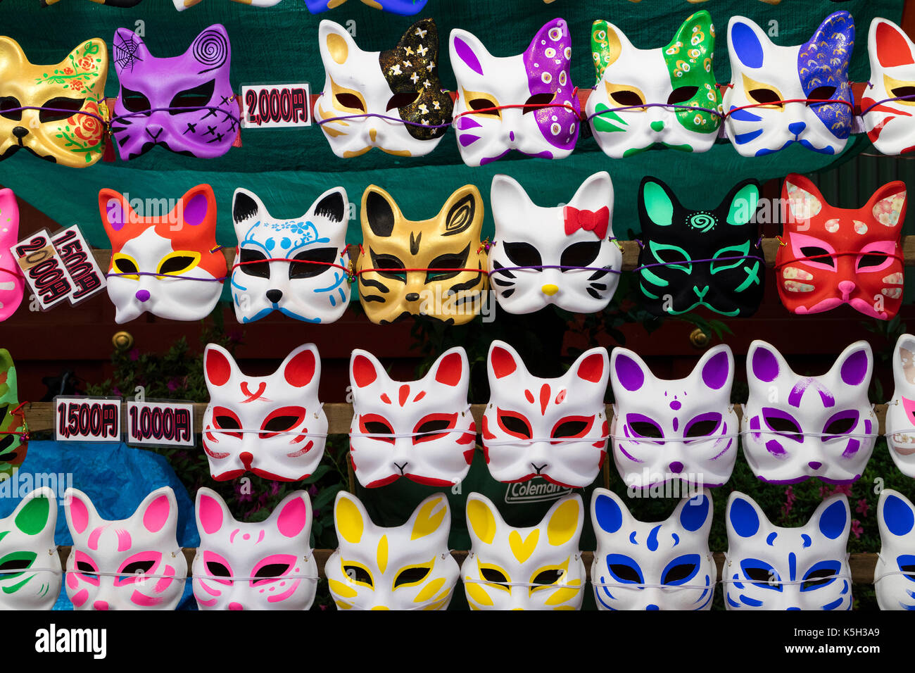 Tokyo, Japan - May 14, 2017:  Cat masks for sale hanging on the wall at the Kanda Matsuri Festival - Stock Image