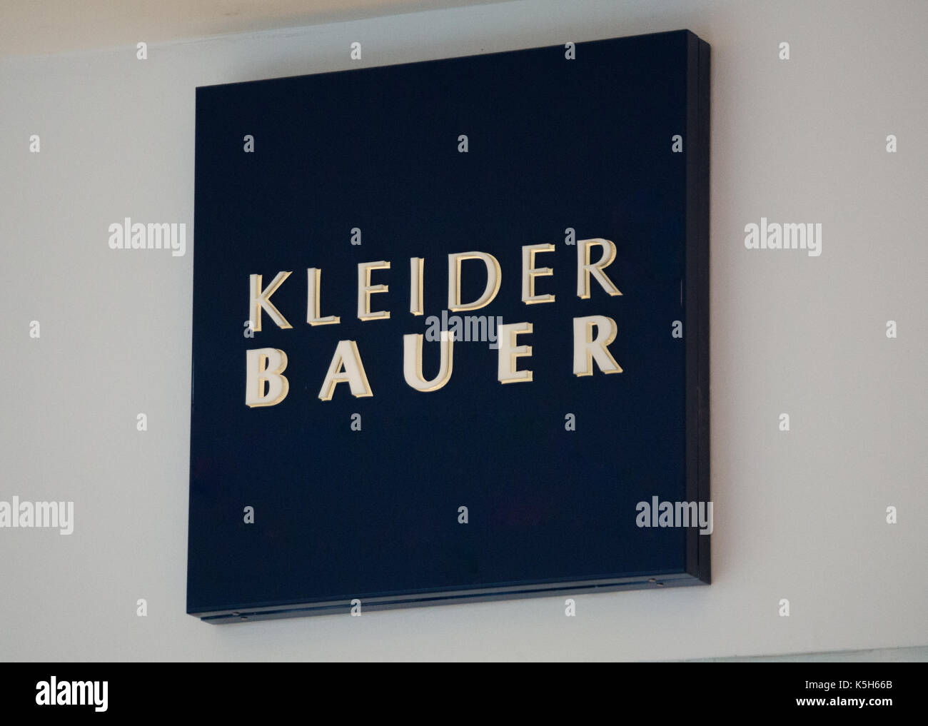 Graz, Austria - September 8th 2017: Kleider Bauer logo above the store entrance at Seiersberg Shopping Center - Stock Image
