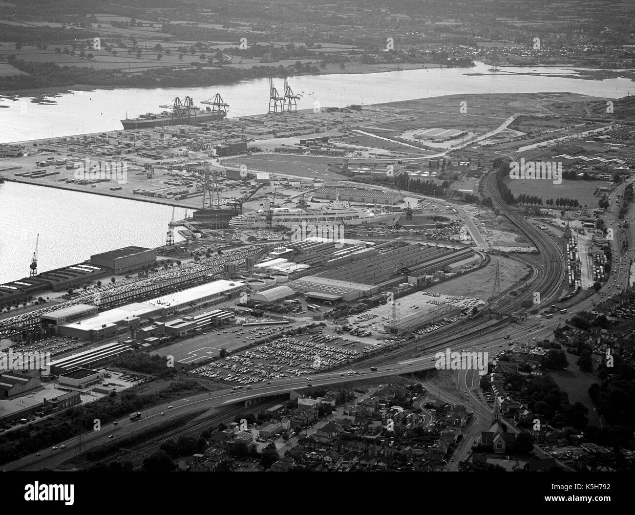 Aerial view of the New Docks and container docks of the Port Of Southampton including SS Canberra in the King George V graving dock, Southampton, Hampshire, England, UK - Stock Image