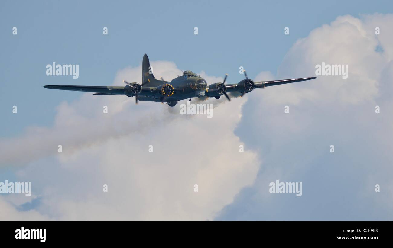 Boeing B-17 Flying Fortress with smoke trailing form its engines in memory of members of Bomber Command Stock Photo