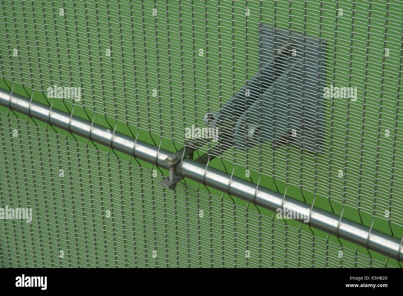 fixation of a steel mesh at a facade - Stock Image