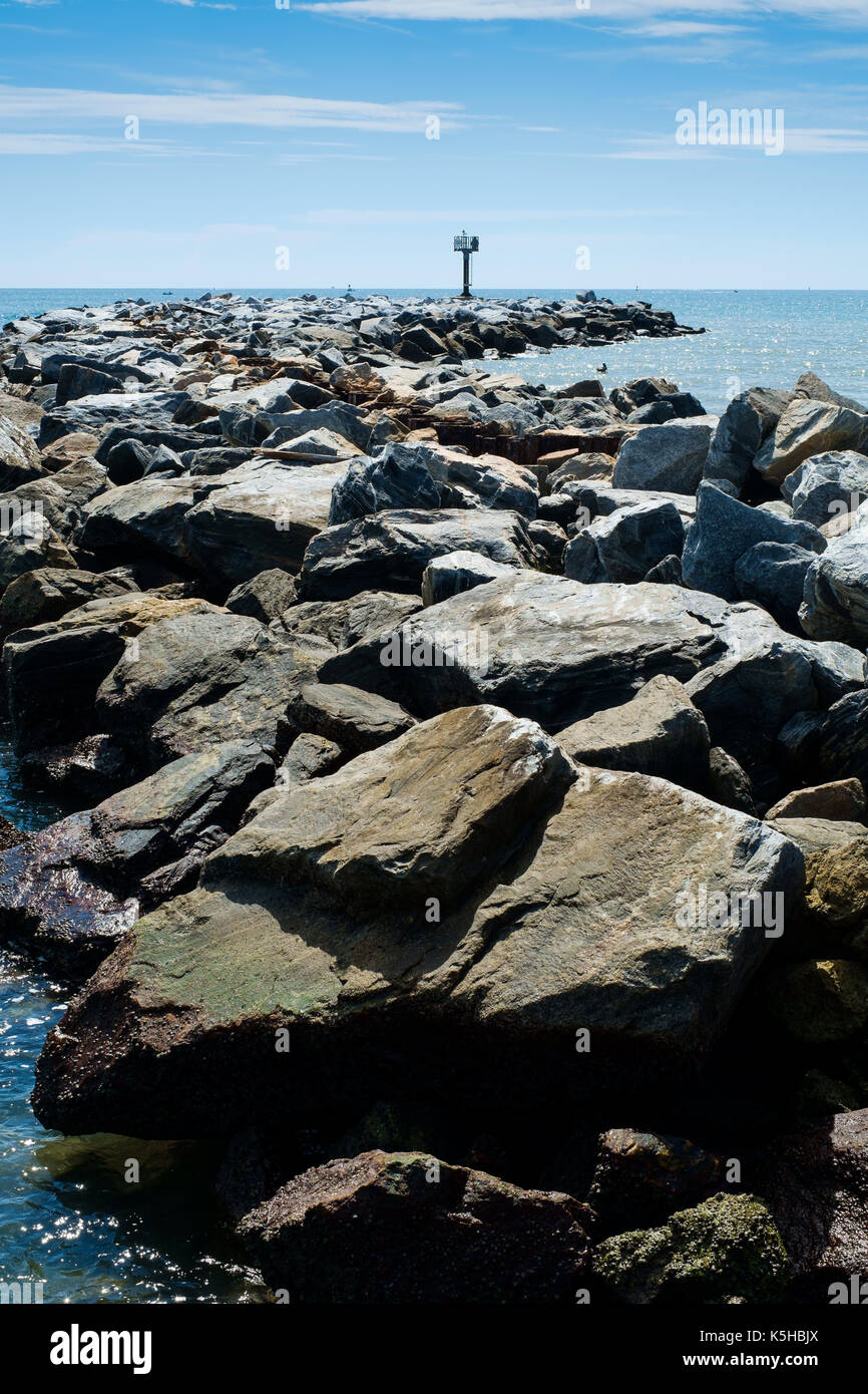 Coastal management with rocks against backdrop of blue sky on Flrida East coast in Summer Stock Photo