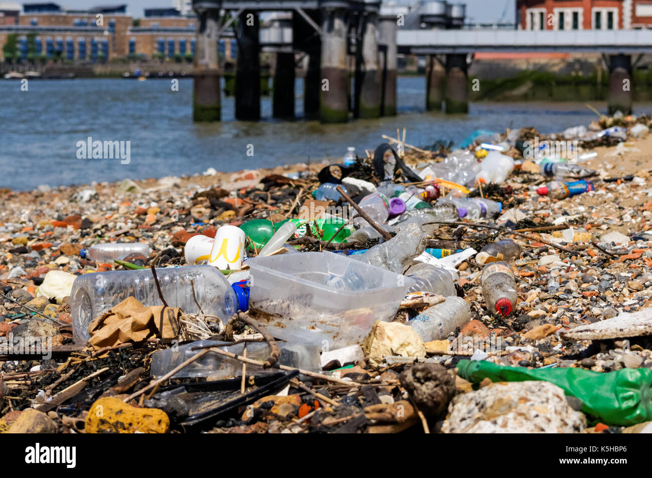 Plastic pollution on the bank of the River Thames, London England United Kingdom UK - Stock Image
