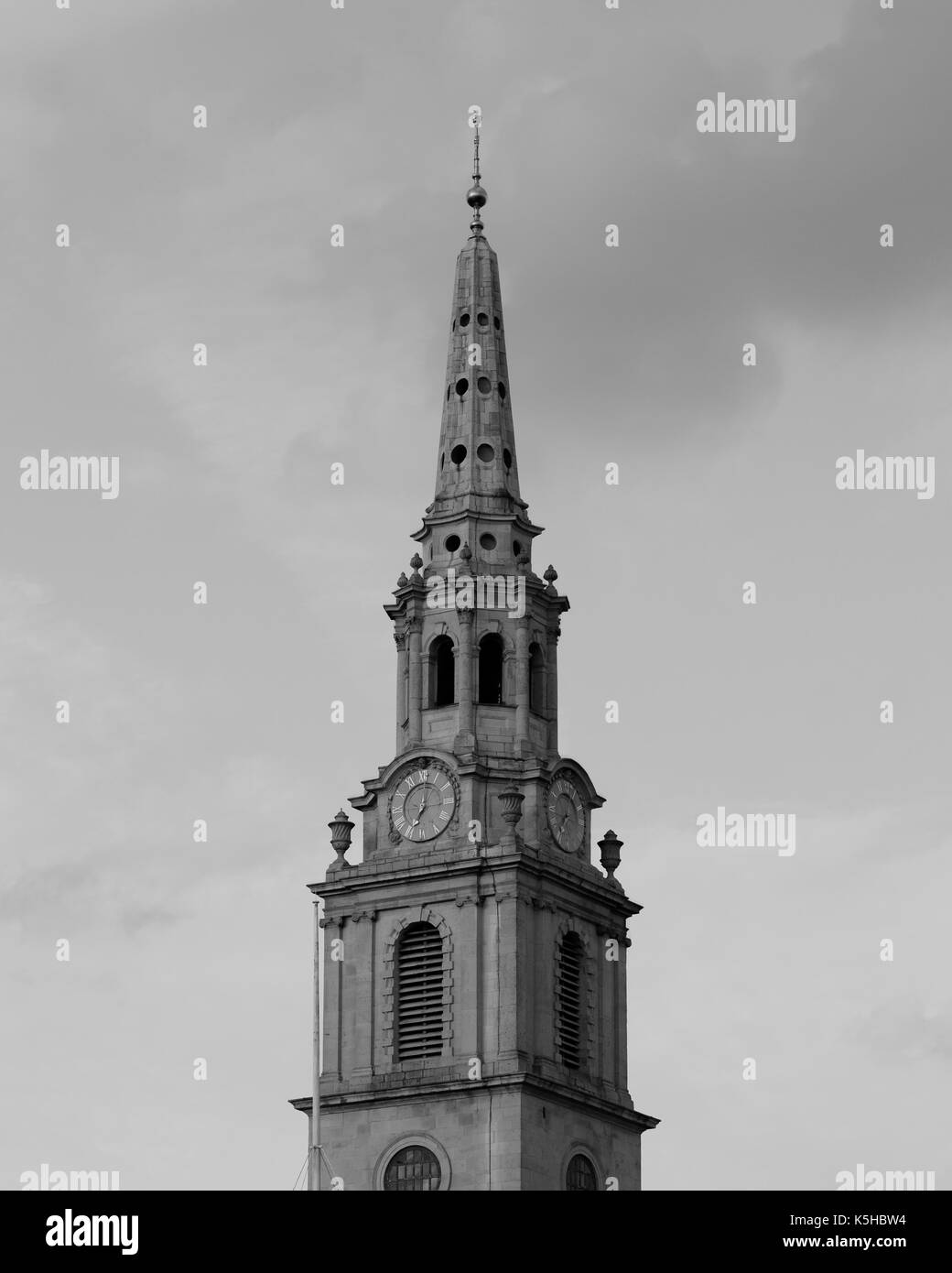 Church spire of St Martin-in-the-Fields at Trafalgar Square, London, UK in black and white - Stock Image