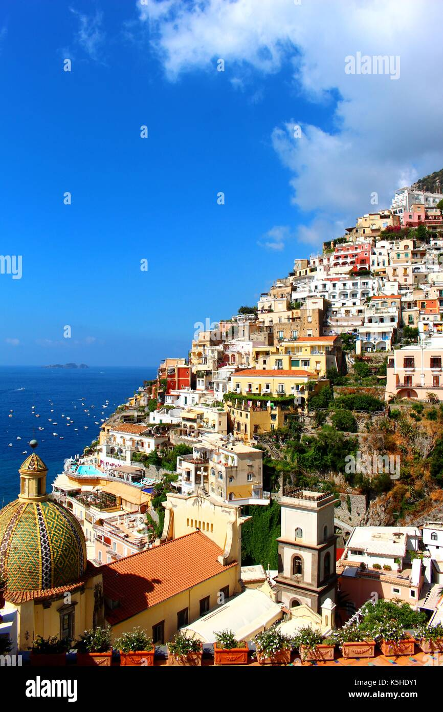 The houses of Positano cling to the steep sides of the Amalfi Coast cliffs by incredible feats of engineering. - Stock Image