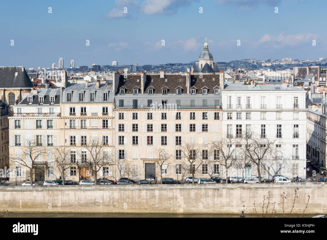 View of apartment buildings on Île Saint-Louis from the roof of the Arab World Institute by the Pont de Sully in Paris - Stock Image
