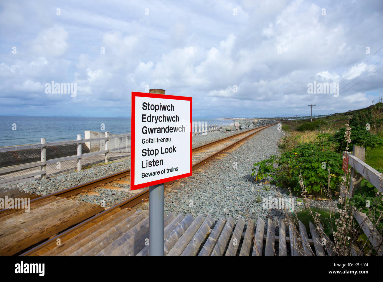 Stop Look Listen warning sign on the Cambrian Coast Line in Wales UK - Stock Image