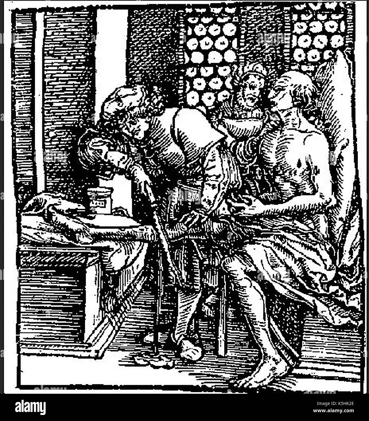 A medieval woodcut showing the amputation of a man's leg using a tourniquet and a saw - Stock Image